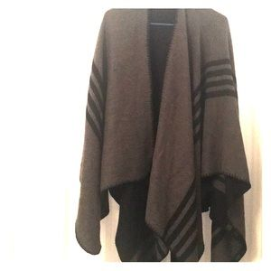 Reversible black and grey poncho.
